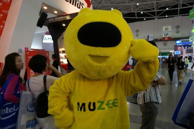 O mascote da Muzee.