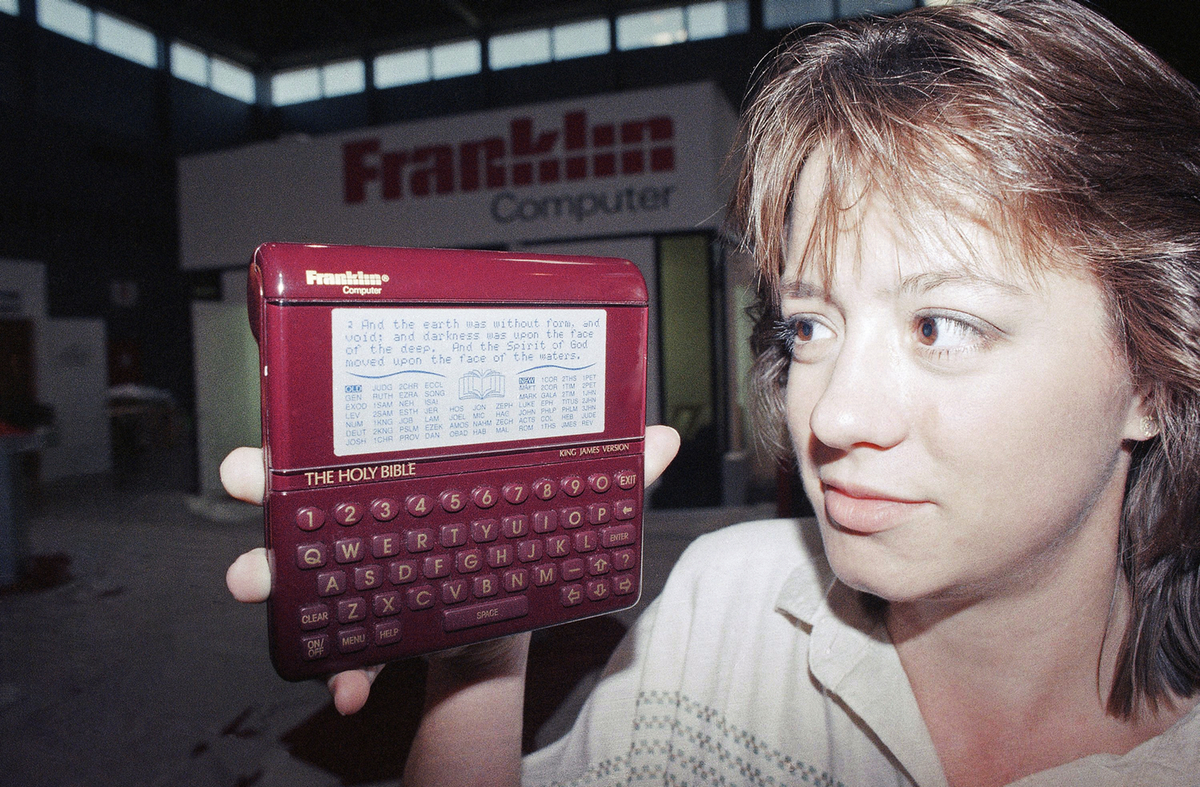 Patricia Ricalton holds a Holy Bible computer