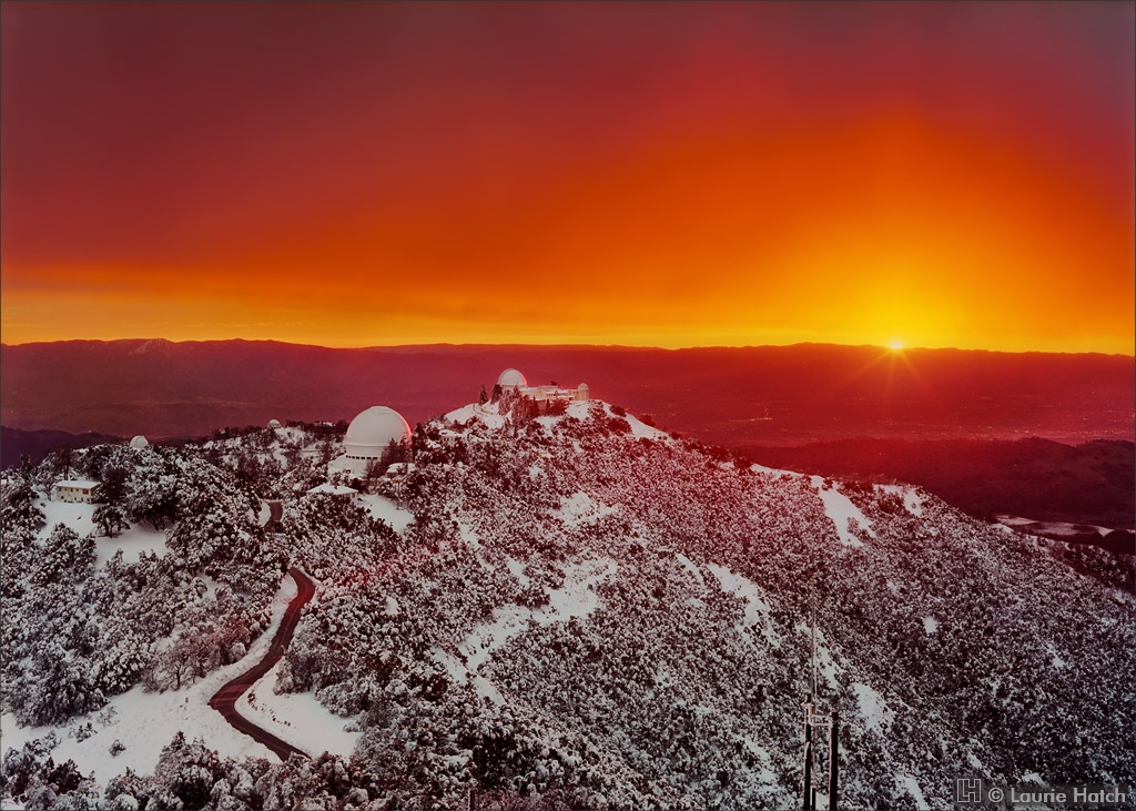 An extraordinary record snowfall and sunset illuminate Lick Observatory on Mt. Hamilton.
