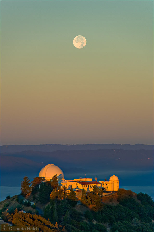 The first light of dawn arrives on Mt. Hamilton in this view looking west the the Lick Observatory Main Building.