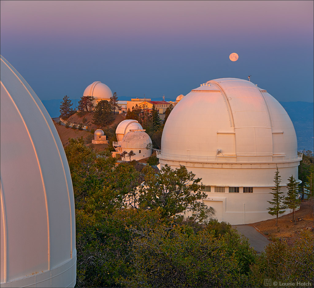 The first light of dawn arrives on Mt. Hamilton, illuminating telescope domes of Lick Observatory.