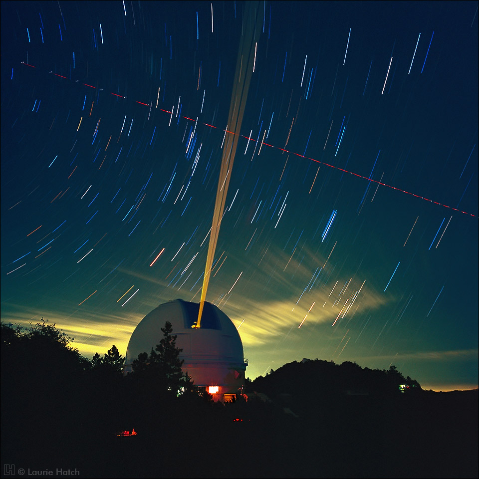 The Shane 3-meter telescope and tracking Laser Guide Star are seen in a lengthy time exposure as dawn begins to brighten the eastern sky.