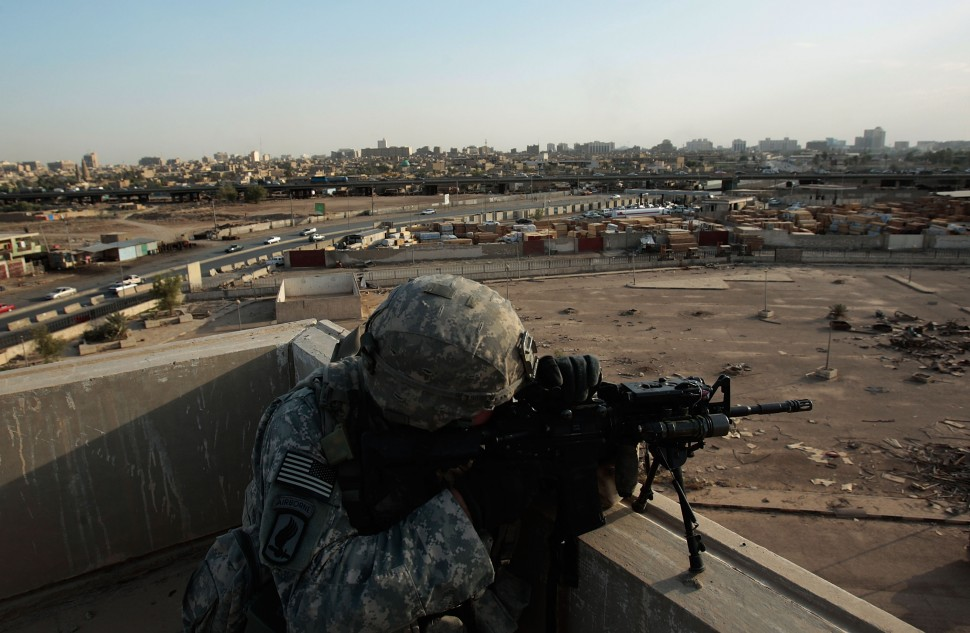 U.S. Soldiers Explore Abandoned Shopping Mall In East Baghdad