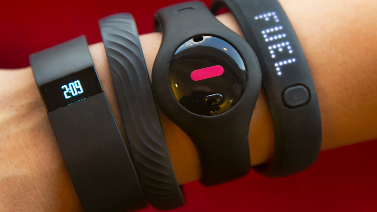 Four fitness trackers are shown in this photograph, in New York,  Monday, Dec. 16, 2013. They are, from left, Fitbit Force, Jawbone Up, Fitbug Orb, and the Nike FuelBand SE.  For aspiring health nuts and to inspire couch potatoes to get active, the latest crop of fitness gadgets will record much more than how many steps you took on any given day. From sleep patterns to calorie intake, mood and progress toward exercise goals, few aspects of life are left un-tracked for those in search for a more quantified self. (AP Photo/Richard Drew)