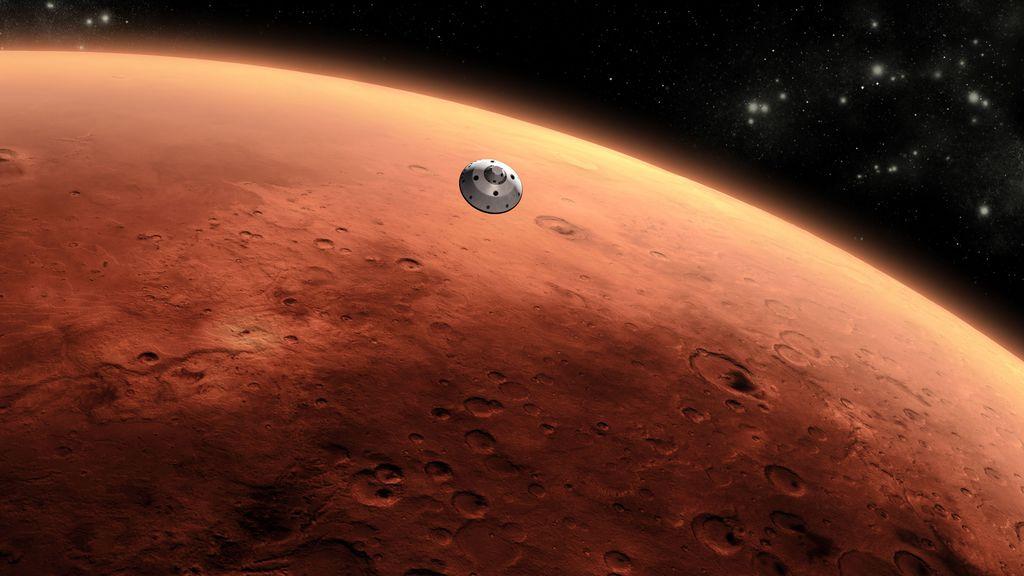 Conceito artístico da sonda Curiosity da NASA se aproximando de Marte. Imagem via NASA/JPL-Caltech