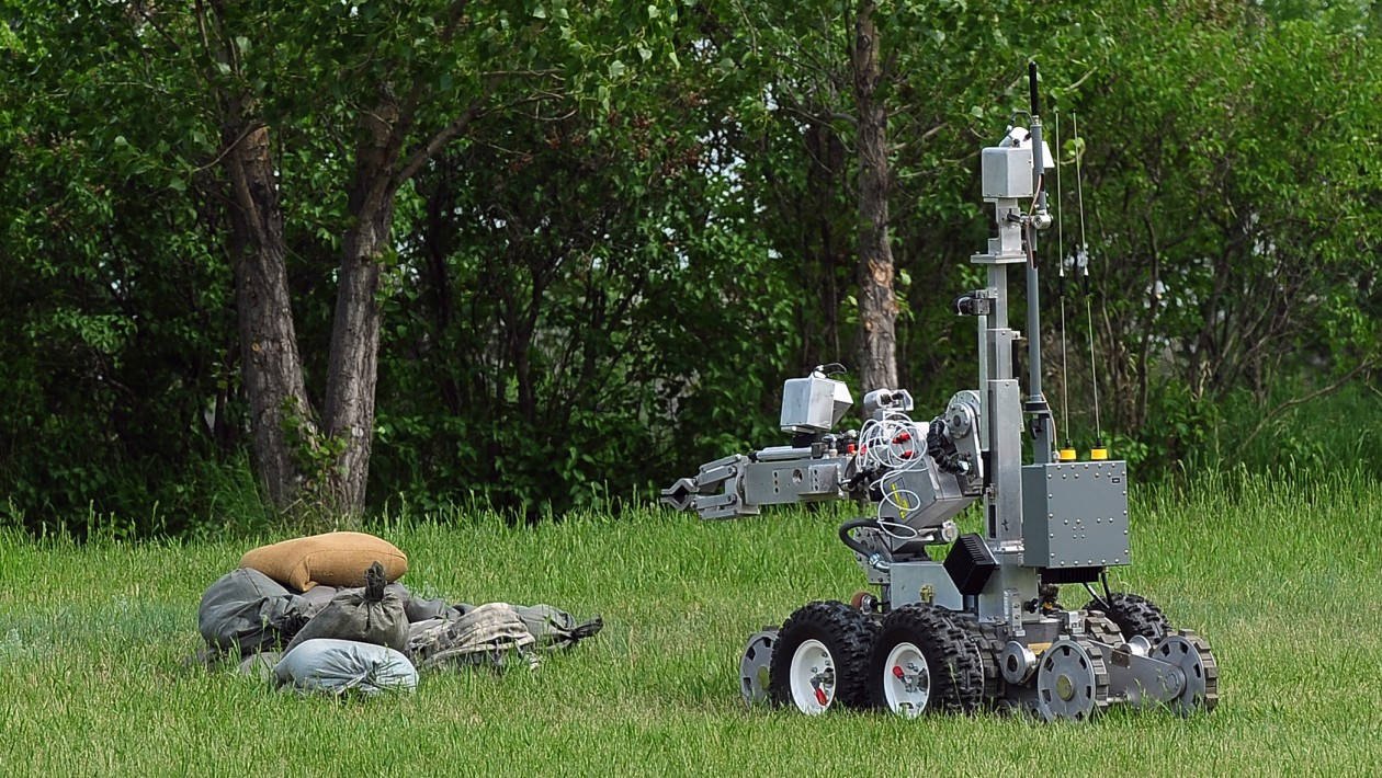 A Northrop-Grumman Remotec Andros F-6A robot remotely operated by members of the 5th Civil Engineer Squadron explosive ordnance disposal, makes its initial approach to a simulated improvised explosive device during an exercise here June 6. The Andros F-6A is used by 5th CES EOD personnel to recon areas not cleared for human entry and disarming potential explosive devices. Exercises like these are vital training tools used throughout the year to ensure wing personnel are trained to provide safe, secure, effective conventional and nuclear operations as mandated by Air Force Global Strike Command.