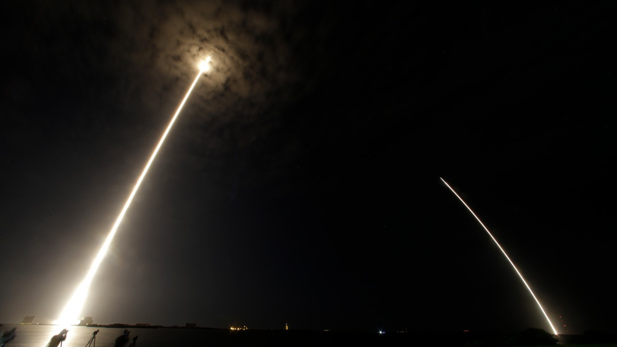 During a time exposure the Falcon 9 SpaceX rocket is seen, left, as it lifts off from launch complex 40 at the Cape Canaveral Air Force Station in Cape Canaveral, Fla., Monday, July 18, 2016. The streak on the right is the booster landing back at the Air Force Station. The Falcon 9 is headed to the International Space Station with 5,000 pounds of supplies. (AP Photo/John Raoux)