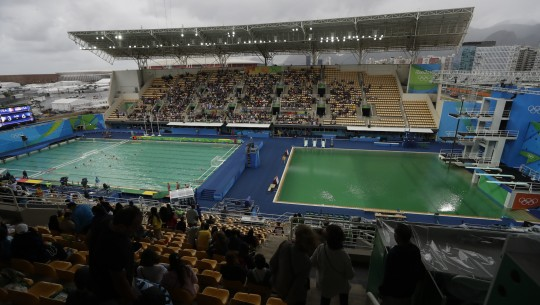 The water of the diving pool at right appears a murky green as the water polo pool at left appears a greener colour than the previous day during a preliminary round match between United States and France in the Maria Lenk Aquatic Center at the 2016 Summer Olympics in Rio de Janeiro, Brazil, Wednesday, Aug. 10, 2016. (AP Photo/Matt Dunham)