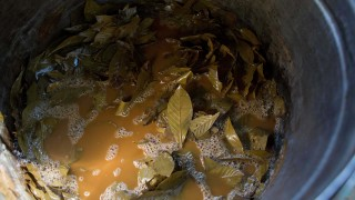 In this June 22, 2016 photo, a cauldron with the mixture of  Jagube (Banisteriopsis caapi) and Chacrona leaves (Psychotria viridis) is brought to a boil during the preparation process of  a psychedelic tea, in Ceu do Mapia, Amazonas state, Brazil. The Cult of the Holy Daime was started in 1930 by a descendant of slaves. (AP Photo/Eraldo Peres)