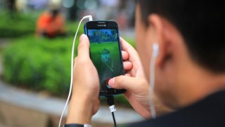 A man plays Pokemon Go at a popular PokeStop in Hanoi, Vietnam on Saturday 13 August 2016. One week after being released in Vietnam, the game has become one of the most talked-about topics in the Southeast Asian country. (AP Photo/Hau Dinh)