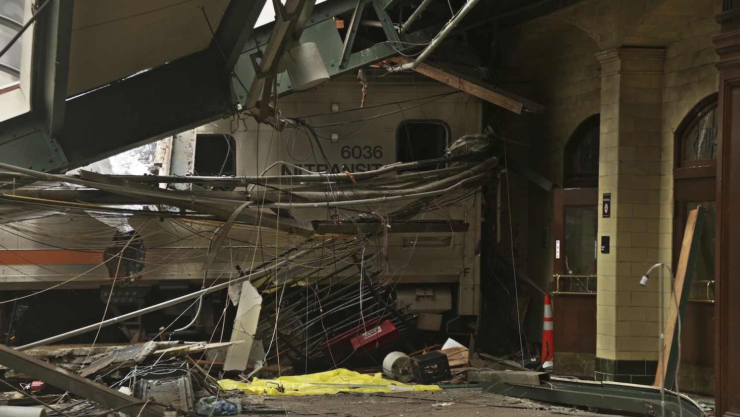 This Oct. 1, 2016, photo provided by the National Transportation Safety Board shows damage done to the Hoboken Terminal in Hoboken, N.J., after a ccommuter train crash that killed one person and injured more than 100 others last week. NTSB vice chair T. Bella Dinh-Zarr said the NTSB is hopeful the data recorder that is in the cab control car in the front of the train is functional. That recorder hasn't been recovered yet because that part of the Hoboken station is still too dangerous to enter due to debris/compromised structure. (NTSB photo by Chris O'Neil via AP)