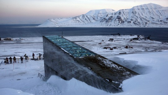 "Snow blows off the Svalbard Global Seed Vault before being inaugurated at sunrise, Tuesday, Feb. 26, 2008. The ""doomsday"" seed vault built to protect millions of food crops from climate change, wars and natural disasters opened Tuesday deep within an Arctic mountain in the remote Norwegian archipelago of Svalbard. (AP Photo/John McConnico)"