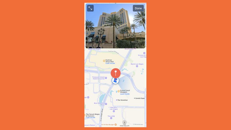 Tela do iOS 13 que mostra o recurso Olhar ao Redor do Apple Maps. Na parte de baixo, há um mapa, e na parte de cima, uma imagem de um hotel que fica nesse lugar no mapa.