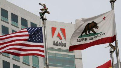 Fachada da Adobe com bandeiras dos Estados Unidos e Califórnia em primeiro plano
