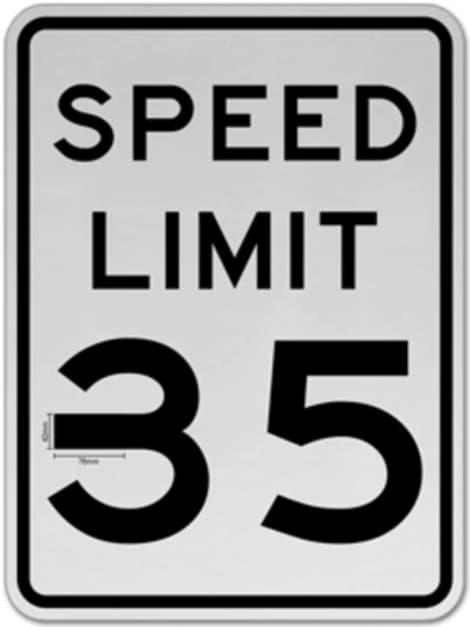 """O sinal de velocidade de 35 MPH com um pedaço de 5 centímetros de fita isolante no """"3"""""""