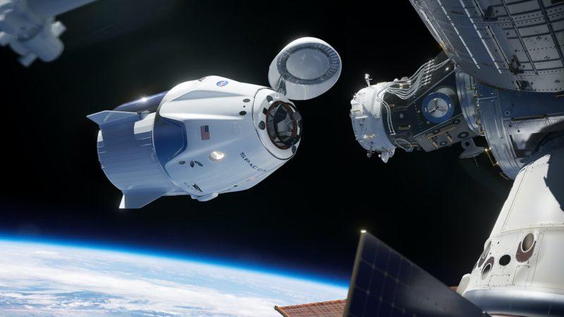 Imagem de conceito da cápsula de tripulação da SpaceX acoplado à Estação Espacial Internacional