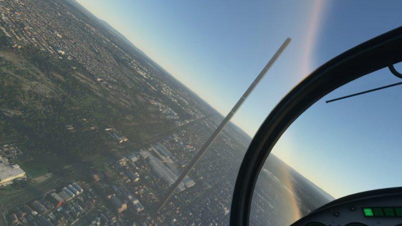 Vista aérea de Melbourne no jogo Flight Simulator. Um prédio muito mais alto que todos os seus arredores aparece no centro da imagem.
