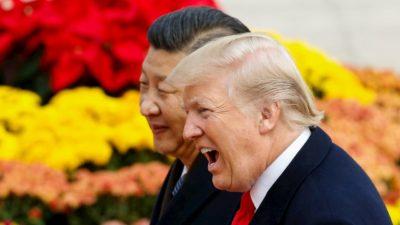 Presidente dos EUA, Donald Trump, e presidente da China, Xi Jinping, lado a lado, vistos de perfil.