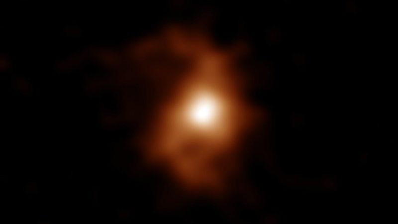 BRI1335-0417, uma galáxia primitiva com estruturas de braços espirais.